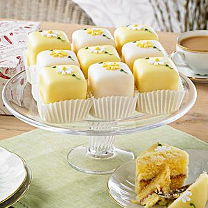 Spring Flowers Fondant Fancies (Box of 9)   Bettys classic Fondant Fancies are made from dainty Genoese sponge cake and are filled with buttercream and raspberry preserve. Each fancy is covered with a layer of marzipan, hand-dipped in fondant icing and individually decorated with delicate hand-piped icing flowers.