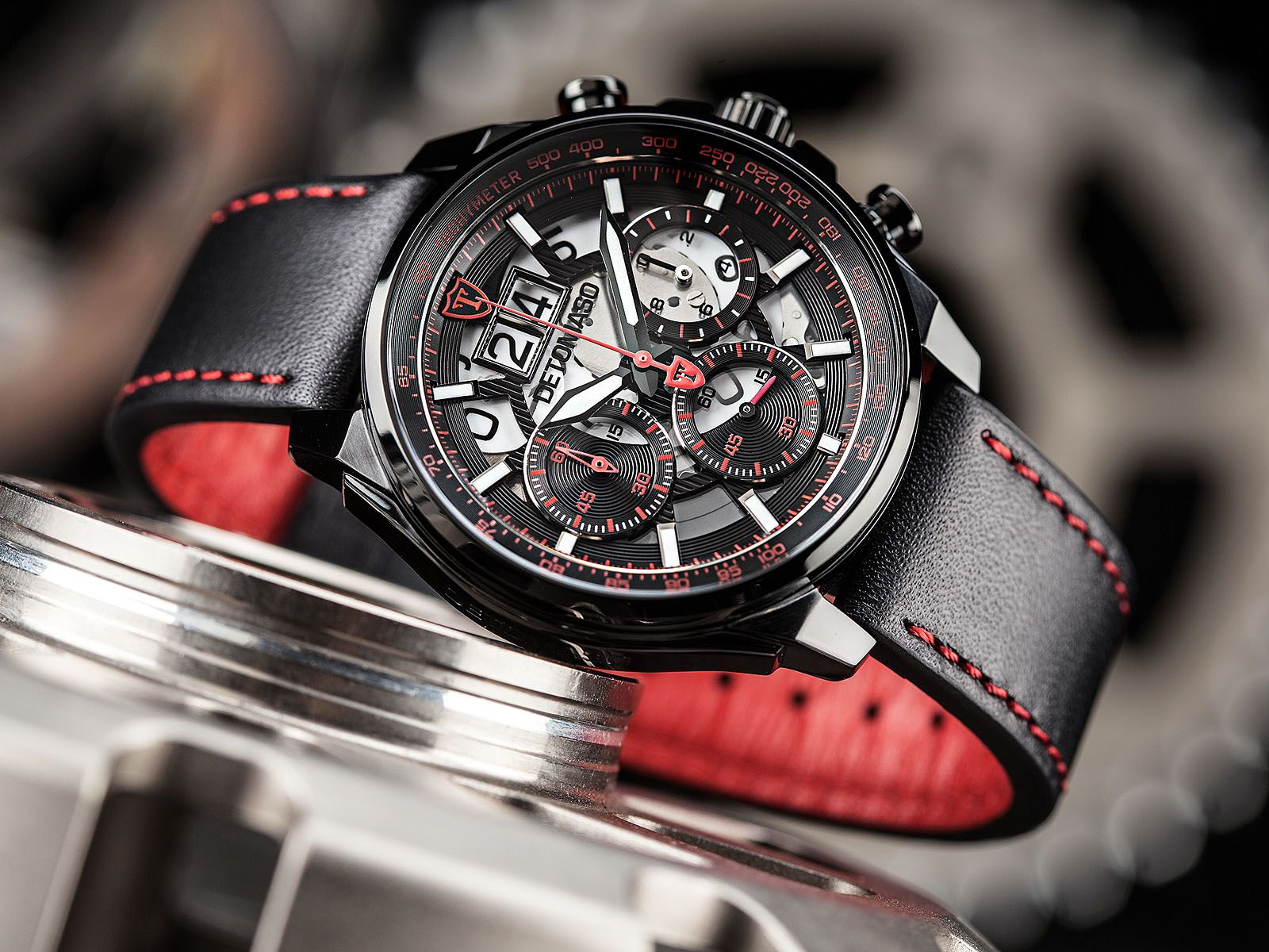 Elaborate design meets athletic needs and they combine into a  black and red hell of a watch.