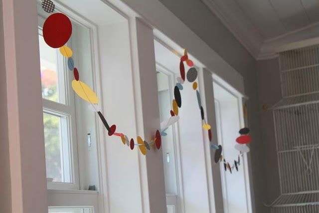 Cute and simple garland from the Pleated Poppy. Just cut circles and sew. I see this appearing at Ethan's first birthday