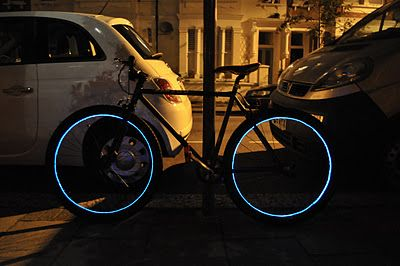 """Using some """"magic wire"""", known as EL wire or Electroluminescent wire & some clear tape, I made my bike look like a light cycle from the movie Tron."""