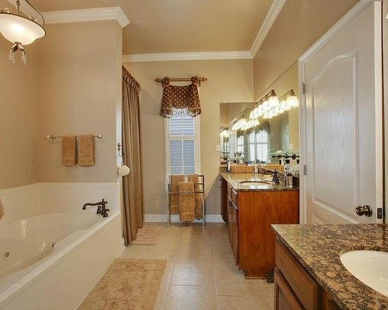 Master Bath with garden tub, separate shower, dual vanities with granite countertops, custom valance and shower curtain