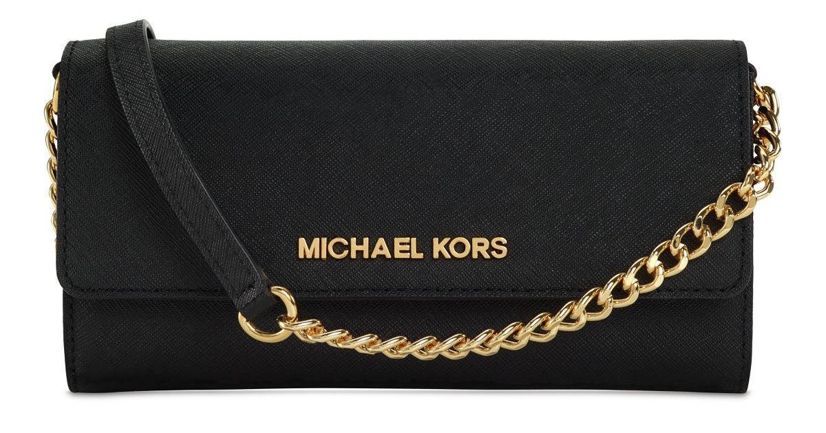 a1e8f0215514 The MICHAEL Michael Kors Crossbody case for iPhone integrates phone  protection with a premium leather designer clutch wallet that holds basic  essentials.