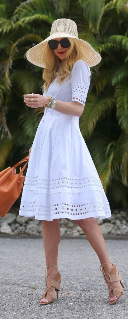 8bea66655824 Turn heads everywhere by pairing your fabulous wide-brim hat with a  feminine sundress! This look is great for tropical vacations