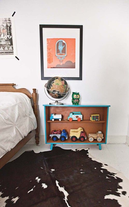 "An eclectic family home in Springfield, MO: ""The little turquoise and orange book shelf beside the guest bed was another flea market find that I spray painted to match the colors in his room. The toy box was made by my husband. I stenciled ""You are My Sunshine"" around the box. It was originally made for Lula, but now resides in Diesel's room."" #sneakpeek"