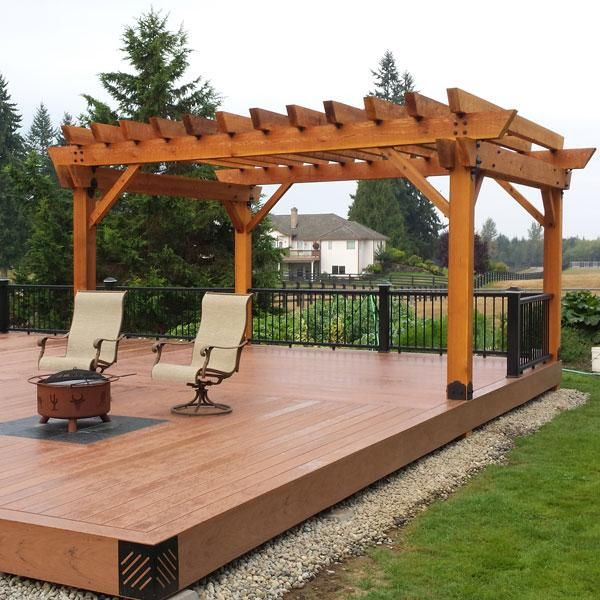 Patio Pergola featuring the POst Base Kit, Post to Beam Bolt Bracket,  Timber Bolts, and Rafter Clips by OZCO Ornamental Wood Ties - Patio Pergola Featuring The POst Base Kit, Post To Beam Bolt Bracket