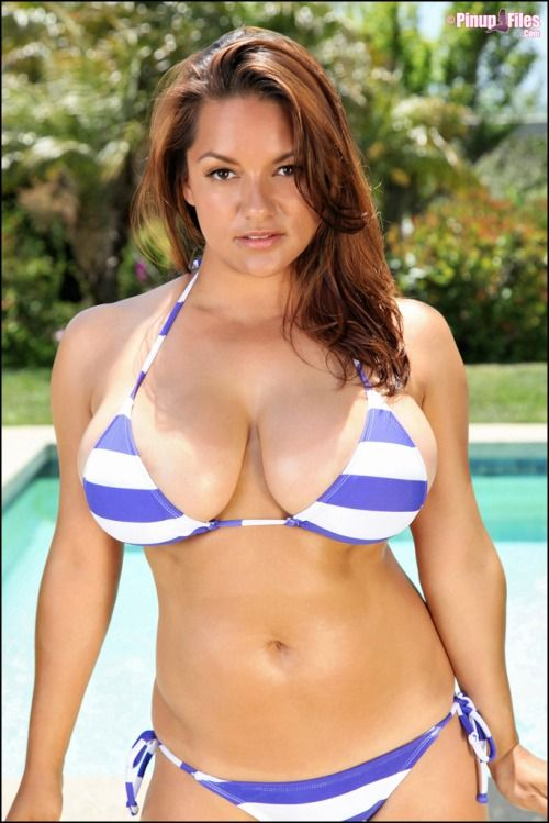 Latina in bikini by a pool the