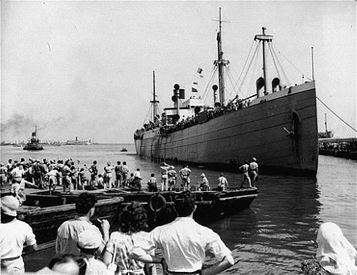 "The Jewish refugee ship ""Pan-York,"" carrying new citizens to the recently established state of Israel, docks at Haifa. The ship sailed from southern Europe to Israel, via Cyprus. Haifa, Israel, July 9, 1948.  — National Archives and Records Administration, College Park, Md."