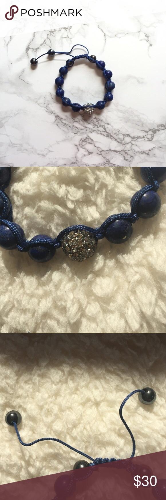 NWOT J.Crew Navy Adjustable Bracelet NWOT Blue adjustable bracelet with a jeweled bead J. Crew Jewelry Bracelets