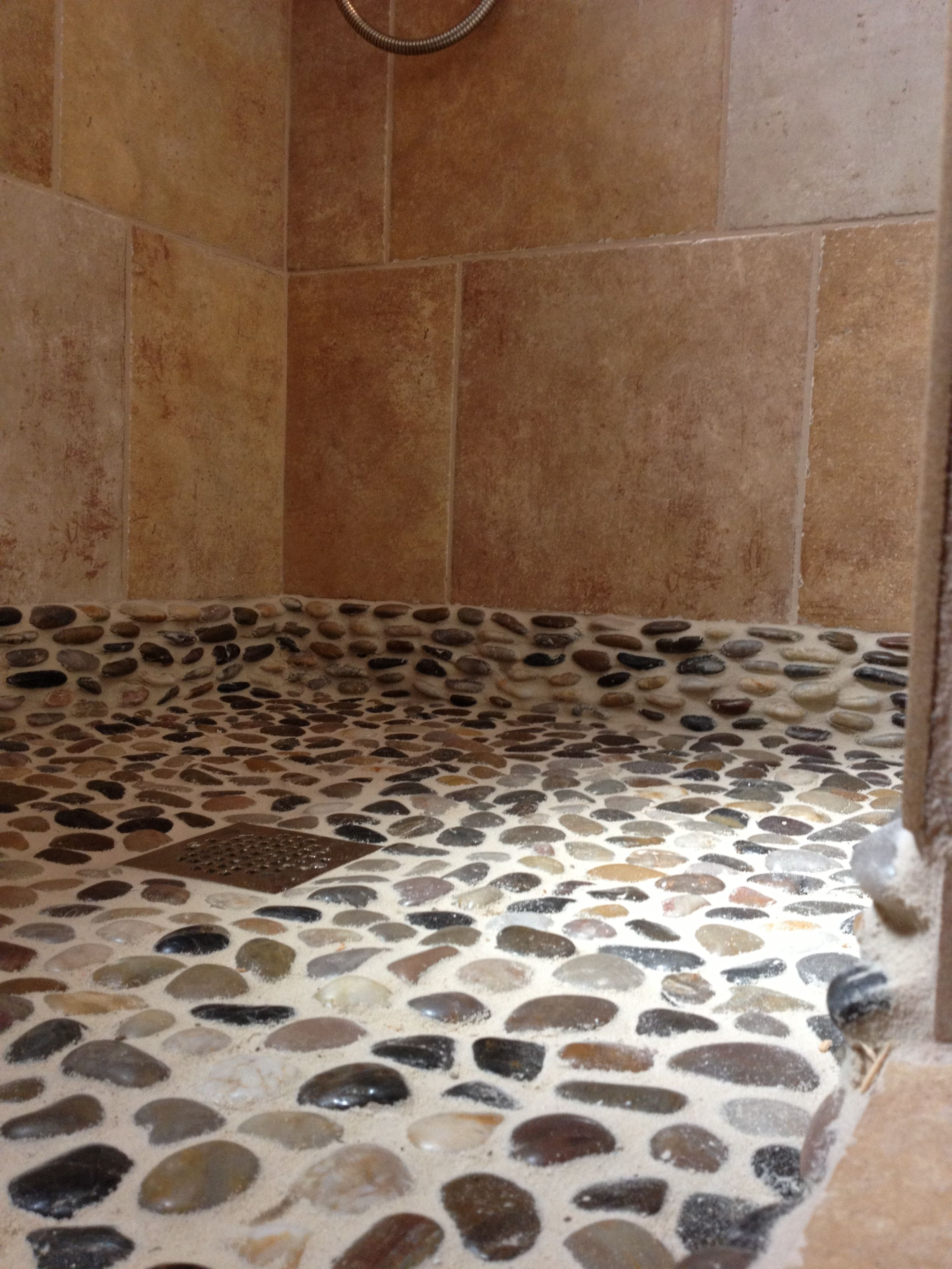 Colored Grout And New Tile Create Fresh Bathroom Look: Pebble Floor With Sand Colored Grout Is Extended Up The