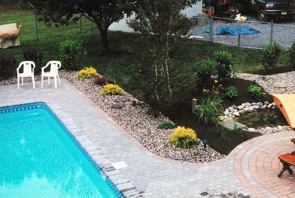 use rocks or oyster shells around pool landscaping Cool Pools