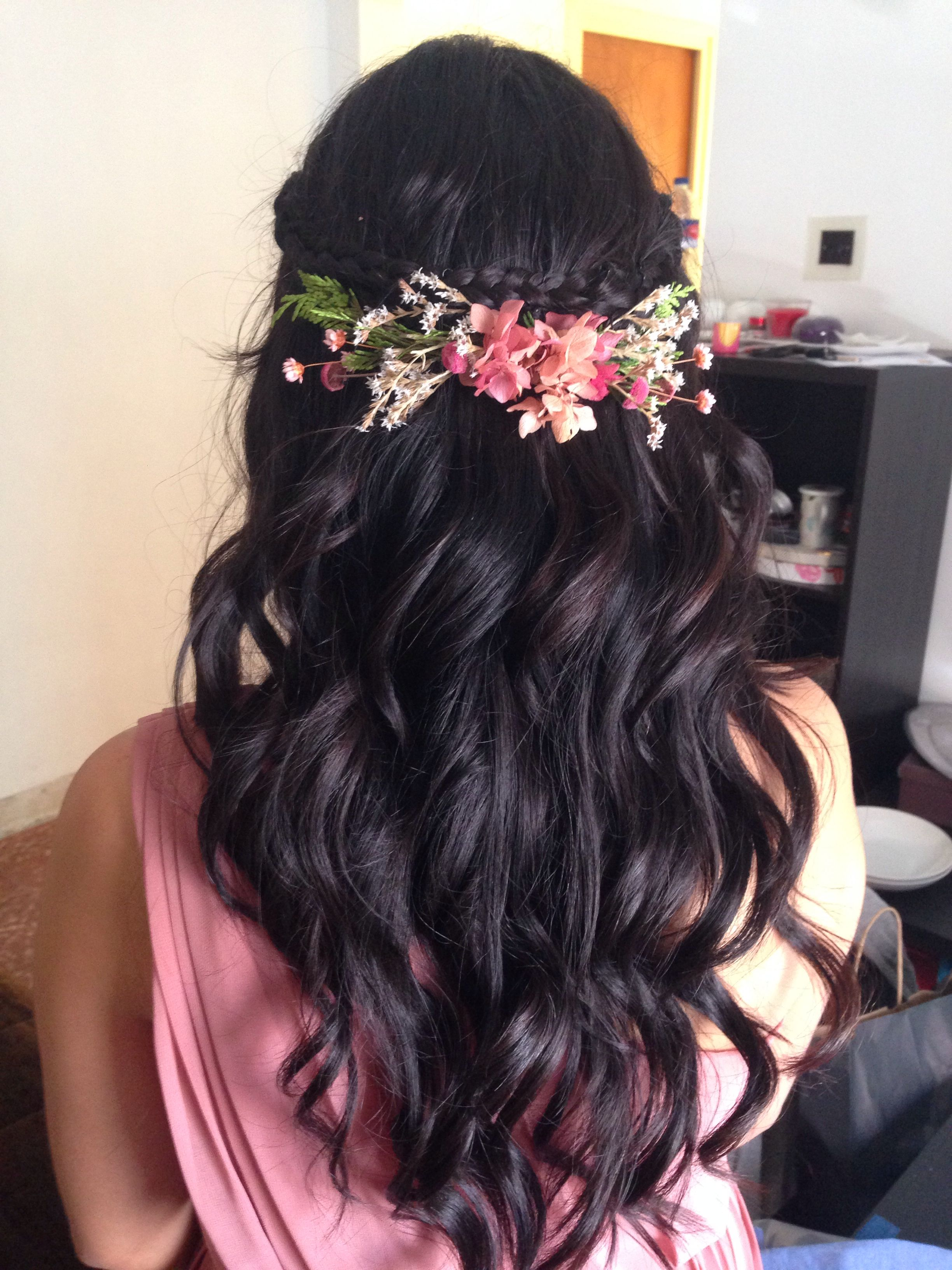 Curly open hair adorned with floral hair clip