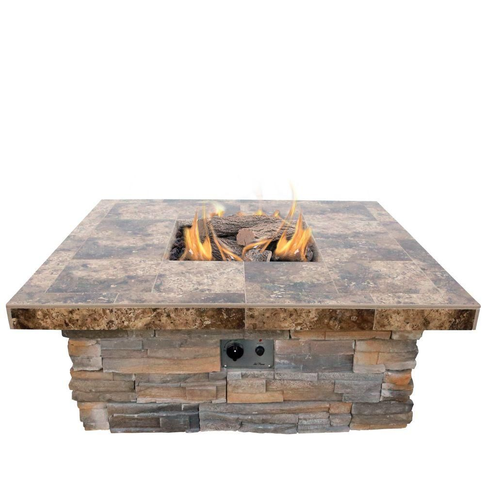 Natural stone propane gas fire pit in gray with log set and lava rocks gray stone and tile