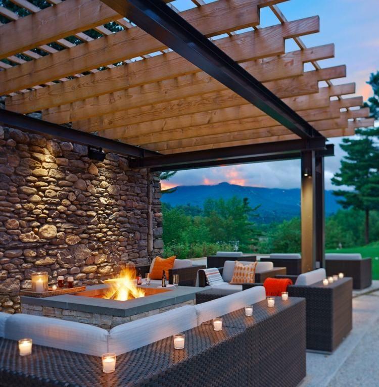 Feuerstelle Terrasse feuerstelle mit ablagefläche holz pergola und rattan möbel