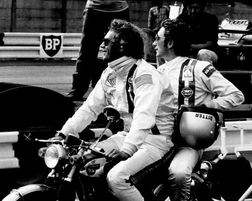 Steve McQueen and Jo Siffert taking a break during the filming of the movie 'Le Mans'. http://www.themanlemans.com/?utm_source=pinterest&utm_medium=breed%20pinterest&utm_content=Motorbikes%20board&utm_campaign=Pinterest%20boards #McQueen #SteveMcQueen #TheManLeMans #LeMans #Motorbike