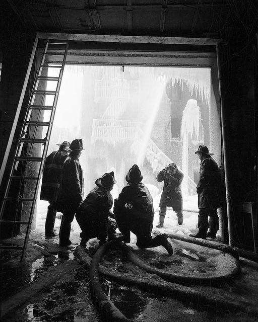 FDNY members responding to a 5-alarm fire at 137th St. and 3rd Ave., Bronx. The fire came to be known as the Ice House fire. Taken Feb. 1, 1957.