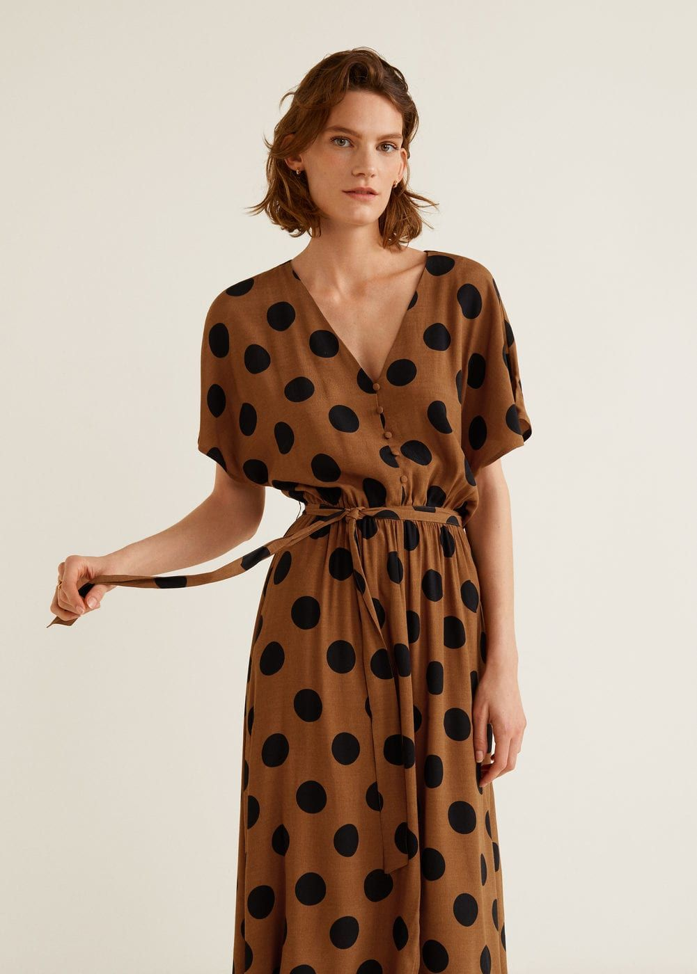 ee443297e0fa Flared design Polka-dot print V-neck neckline Short batwing sleeve Elastic  waist Detachable bow at the waist Front cutout Button front