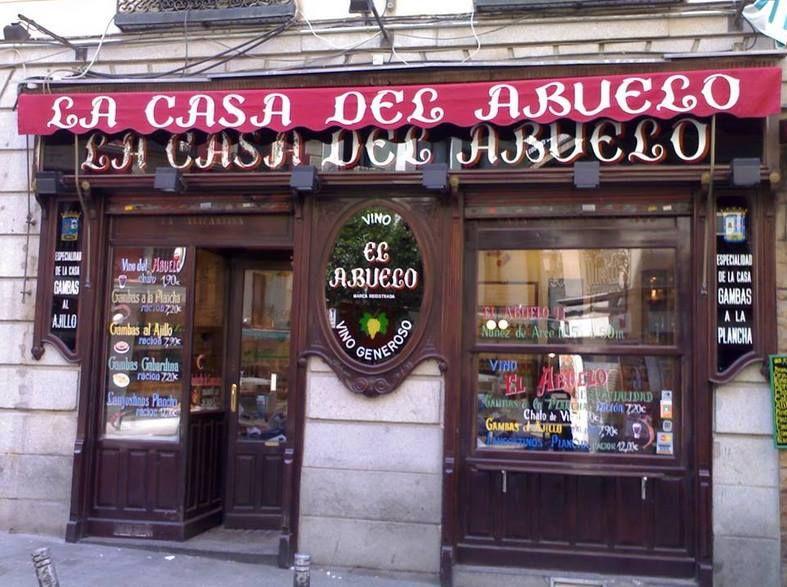 """¿que madrileño no ha pasado por """"Casa del abuelo"""" a tomar un vinito tinto y unas gambitas a la plancha? —"""