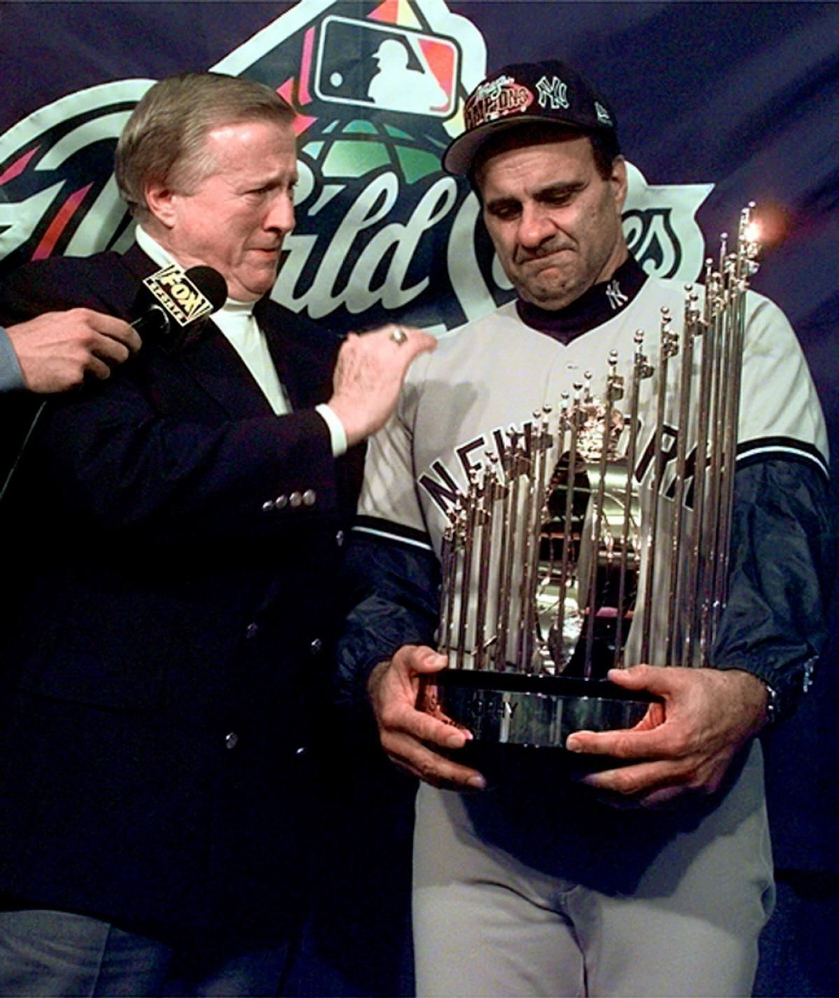 Yankees Owner George Steinbrenner And Torre Get Emotional After Being Presented With The World Series Trophy After The Ya Joe Torre New York Yankees Ny Yankees