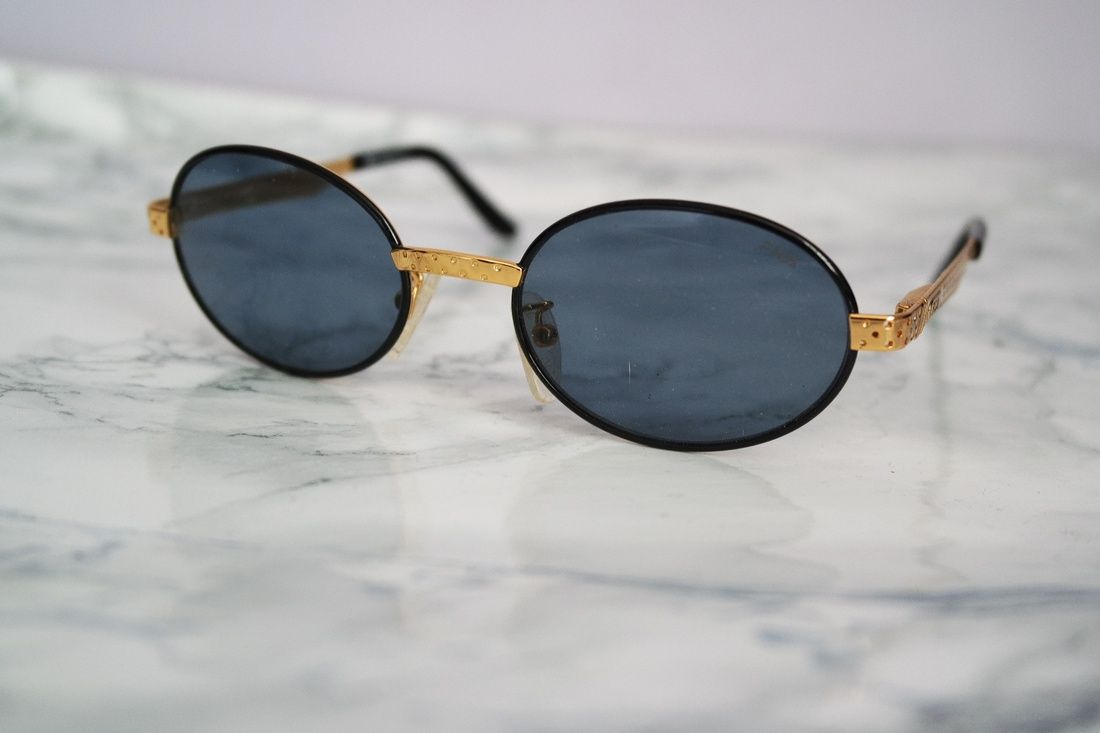 4fe61abff Fila New Fila Vintage Mod 8004 Black/Gold Sunglasses Size One Size $200 -  Grailed. Items similar to Police ...