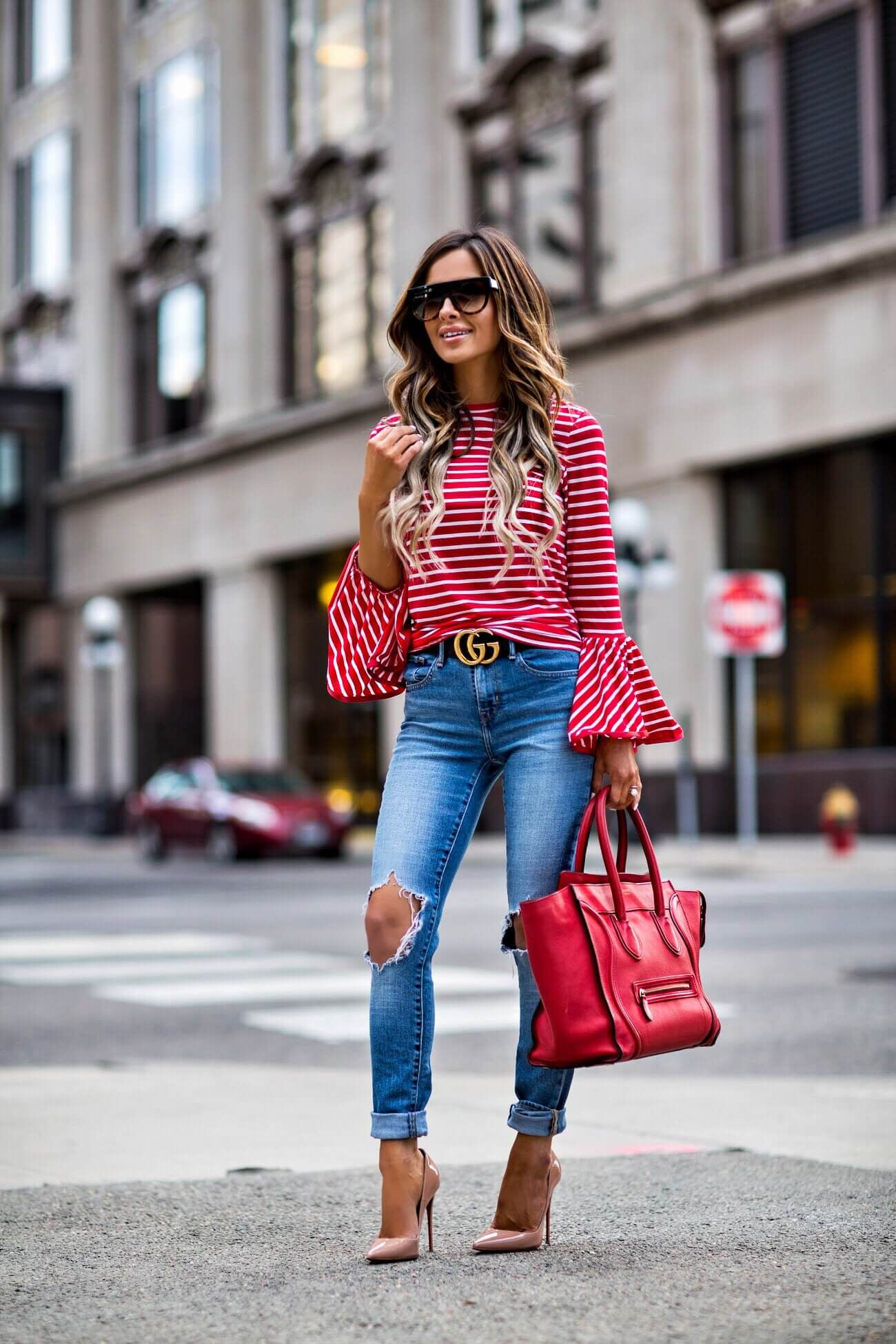 mn fashion blogger mia mia mine wearing a red striped top and levi's distressed jeans from shopbop