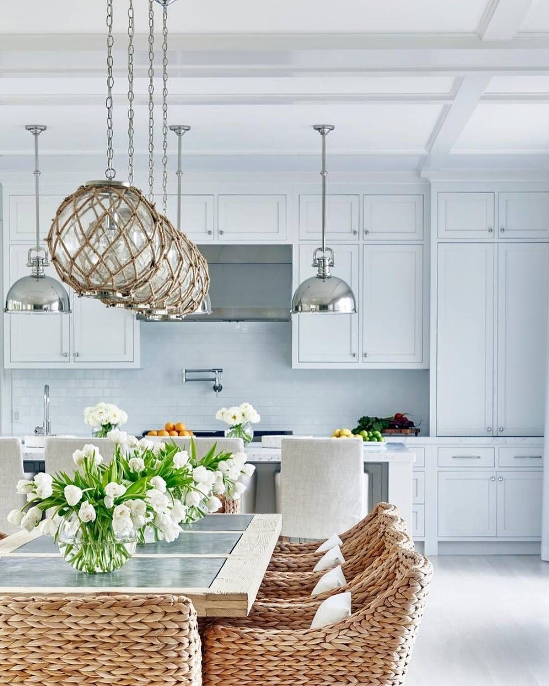 This cozy kitchen full of fresh florals will never go out of style ...