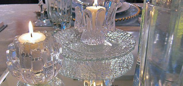 Candles in crystal holders designed to emulate ice and resting on mirrored place mats! The perfect winter accent!
