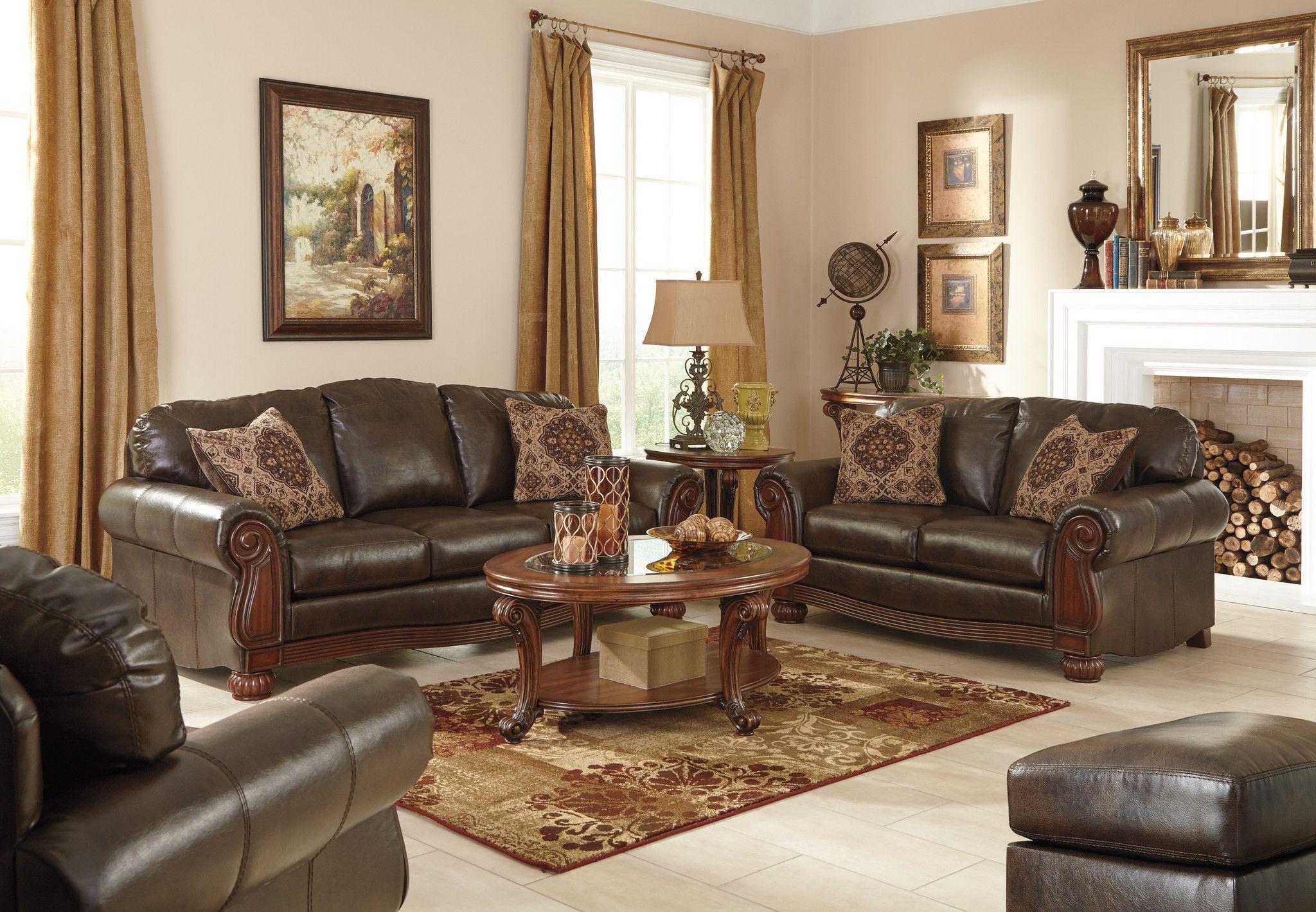 Rodlann Bonded Leather Sofa Loveseat