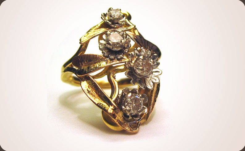 A fantastic 18ct yellow and white gold flower ring. Hand crafted and hand engraved