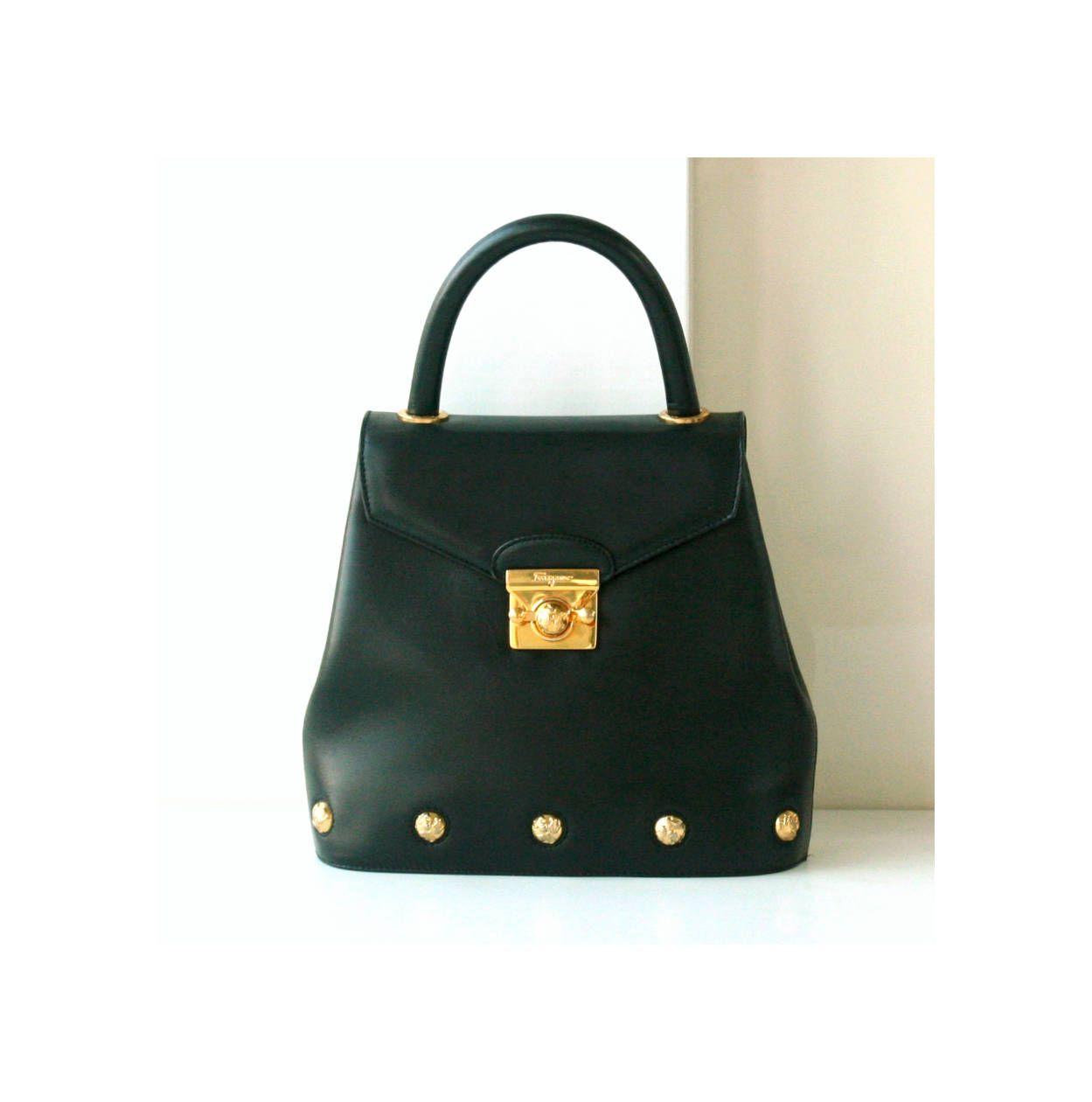 Salvatore Ferragamo Black Leather Tote Bag Gold Shoes Button Vintage  authentic purse by hfvin on Etsy  salvatoreferragamo  ferragamo  black   goldshoes  bag ... 3ac34906dbdc5