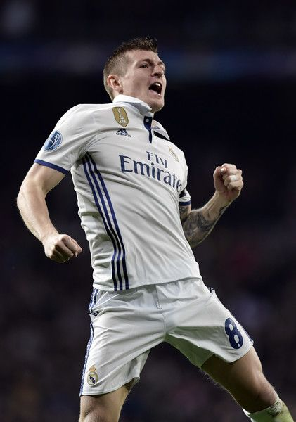 92c12d2a16d Real Madrid s German midfielder Toni Kroos celebrates a goal during the  UEFA Champions League round of 16 first leg football match Real Madrid CF  vs SSC ...
