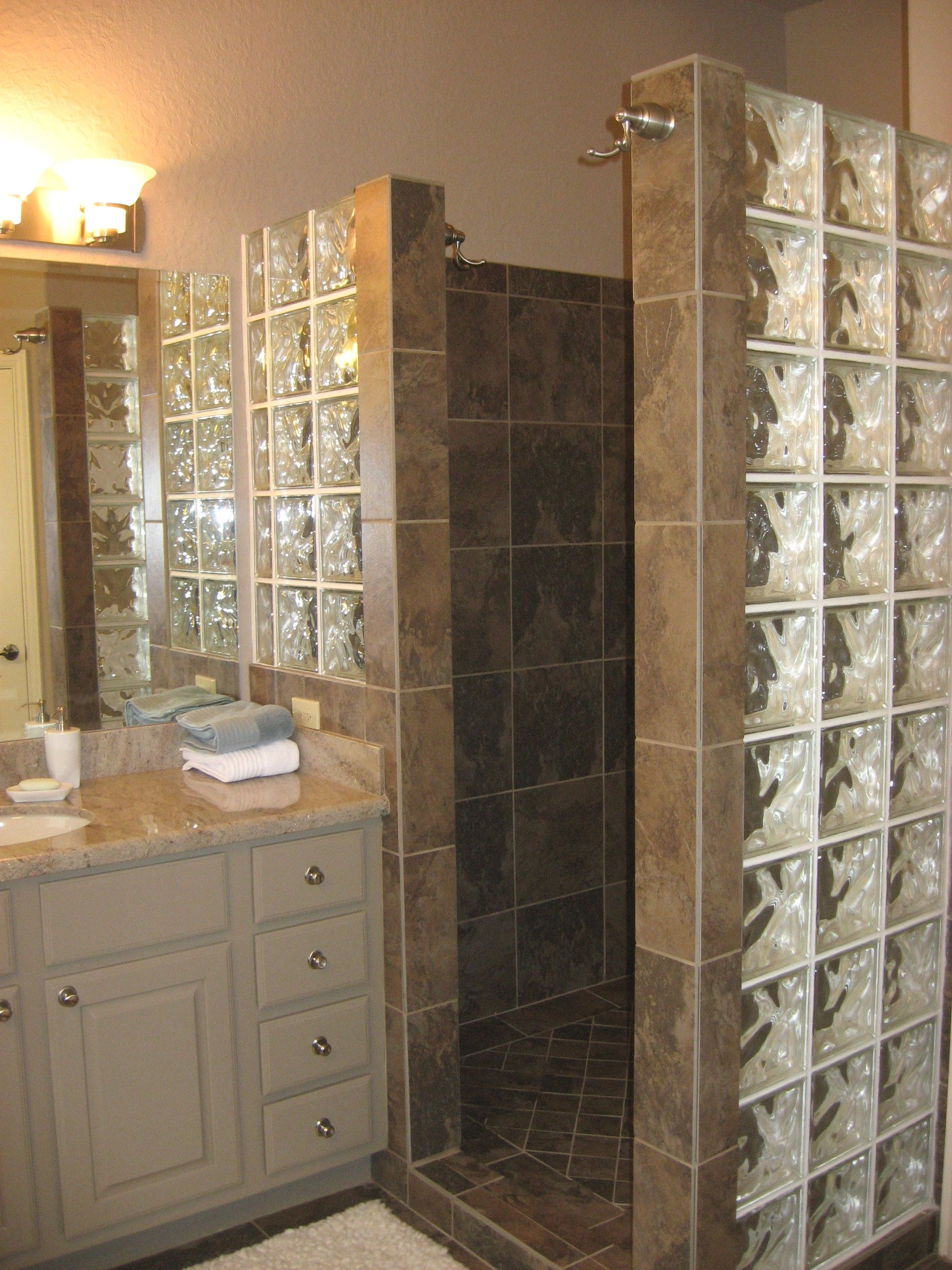 Custom walk in shower with no door and glass block for for Bathroom designs glass