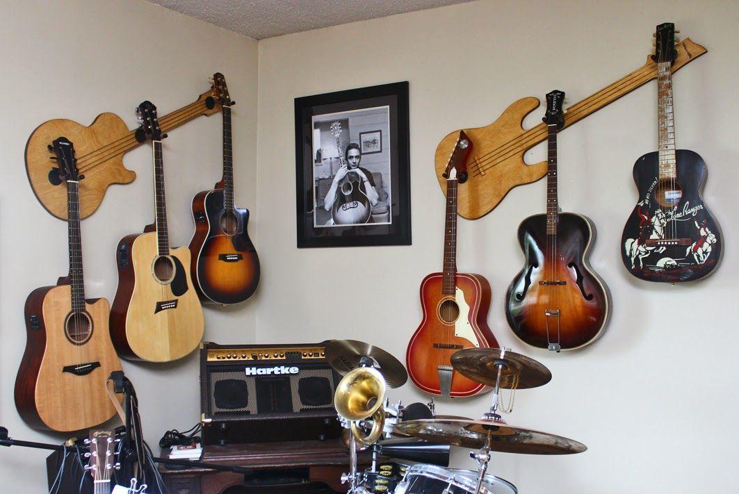 Hang Guitar On Wall wall-axe custom guitar hangers | guitar hangers | pinterest