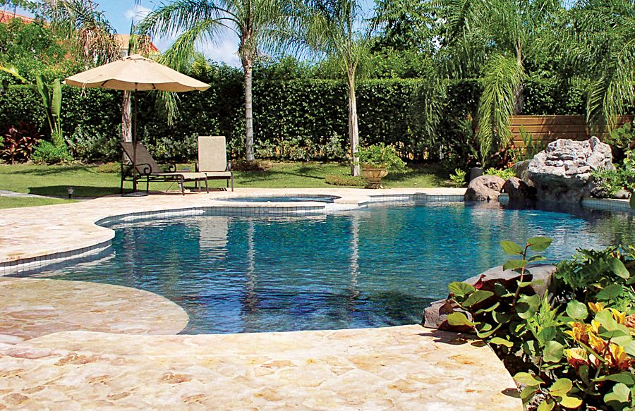 Zero beach entry pool with rock waterfall by Blue Haven Pools ...