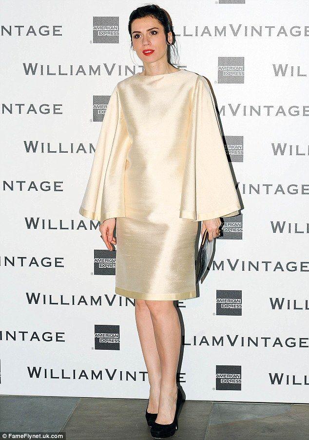 2-14-14.   Chic: Accessories designer Lara Bohinc wore a silky cream bat wing dress to the star-studded event
