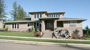 This Is A Prairie Style House Because It Has A Low Pitched Roof, And Wide