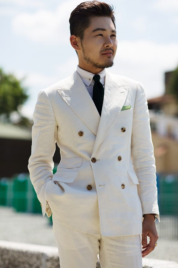 In last pitti uomo. Weared Tailorable wine label White linen DB suit!  Shot by The Sartorialist.