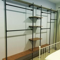Pipe shelves. Could be cool for closet organization