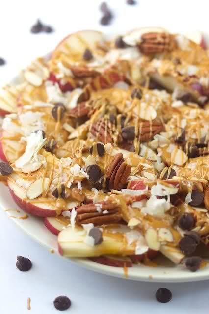 Apple Nachos  3 crispy and slightly tart apples   1 tsp lemon juice   3 tbsp creamy peanut butter   1/4 cup sliced almonds   1/4 cup pecans   1/4 cup flaked unsweetened coconut   1/4 cup chocolate chips   slice apples thin  lightly spritzed the apples with lemon juice melted peanut butter–until super runny–and drizzle over the apples. top apples and peanut butter with unsweetened flaked coconut sliced almonds, pecans and chocolate chips.