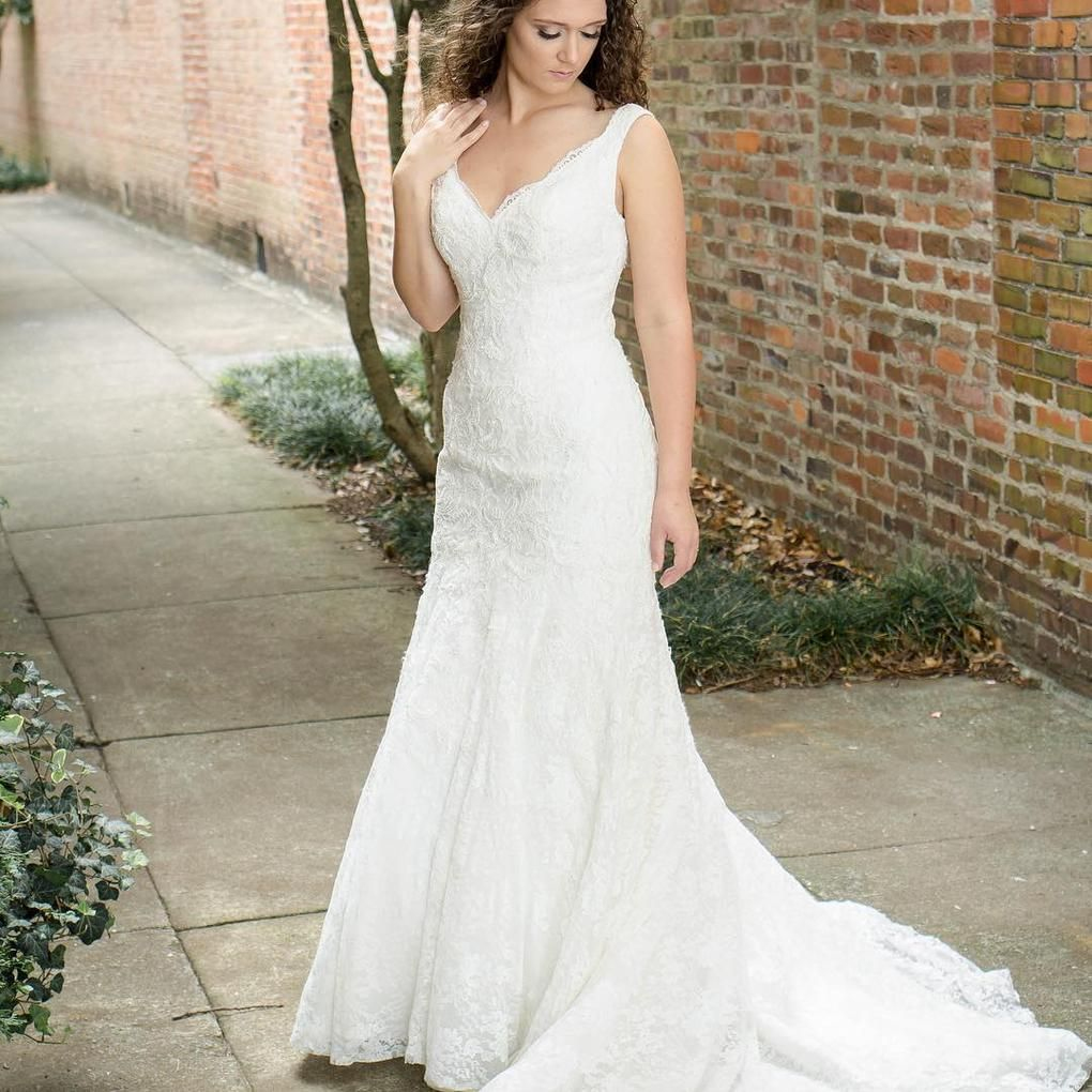 This elegant lace trumpet gown is truly lovely finished with