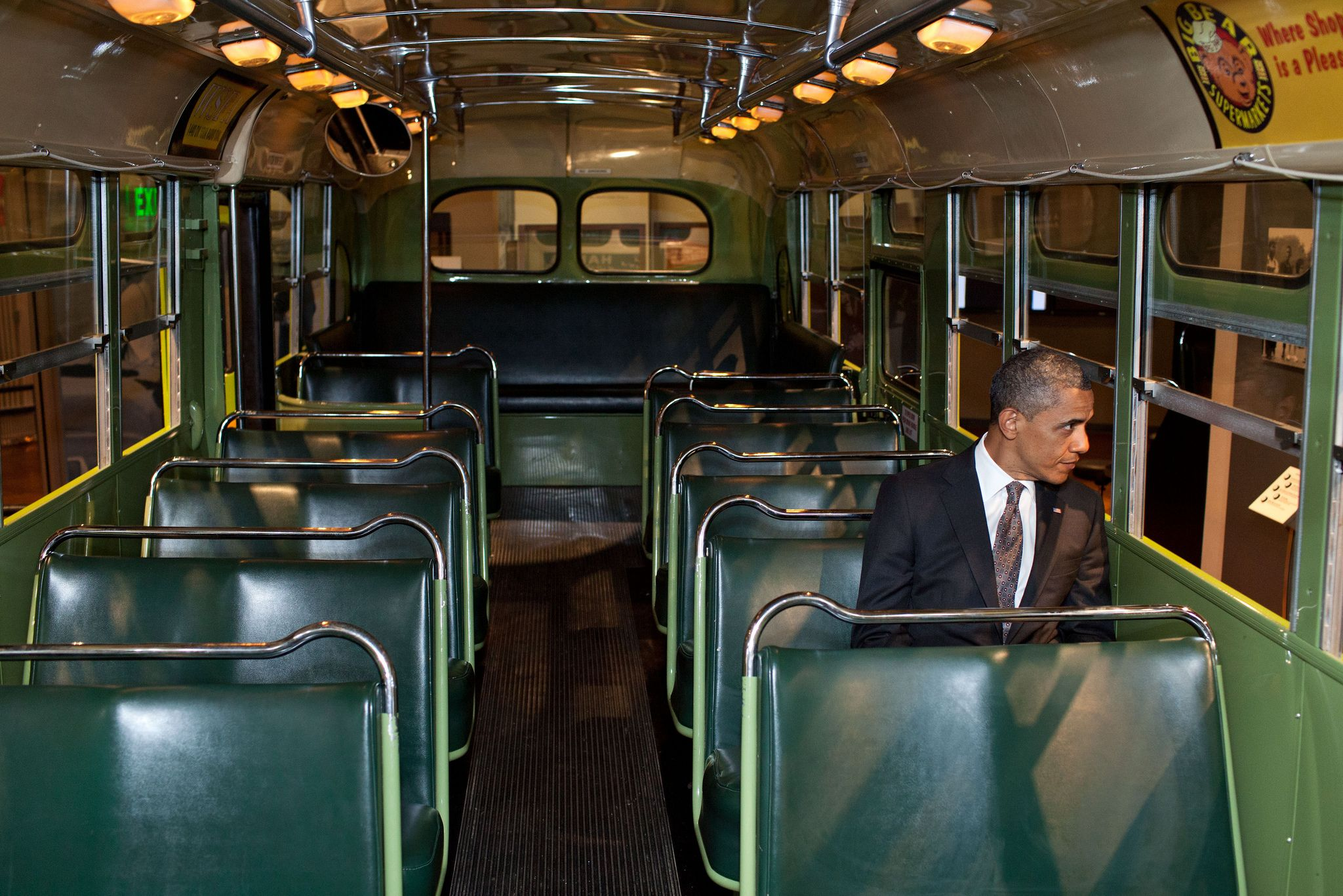 President Barack Obama sits on the famed Rosa Parks bus at the Henry Ford Museum following an event in Dearborn, Mich., April 18, 2012. (Official White House Photo by Pete Souza)  This official White House photograph is being made available only for publication by news organizations and/or for personal use printing by the subject(s) of the photograph. The photograph may not be manipulated in any way and may not be used in commercial or political ma...