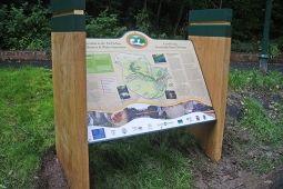 Bespoke wooden lectern with an interpretation panel for Cyfarthfa Leat, Wales.