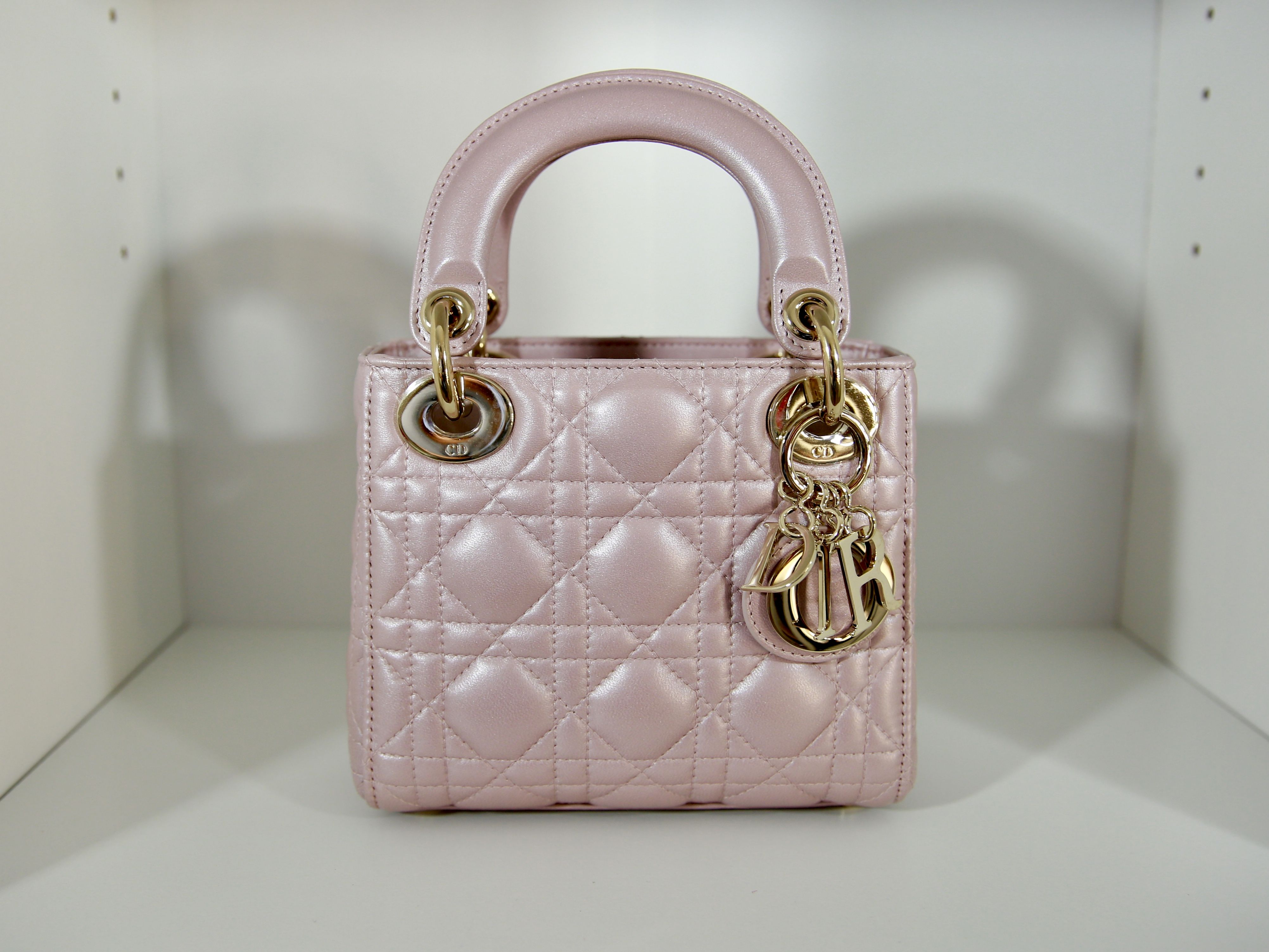 5d0b8ed4832d Lady Dior Mini in pearly lambskin in pink rose gold color https