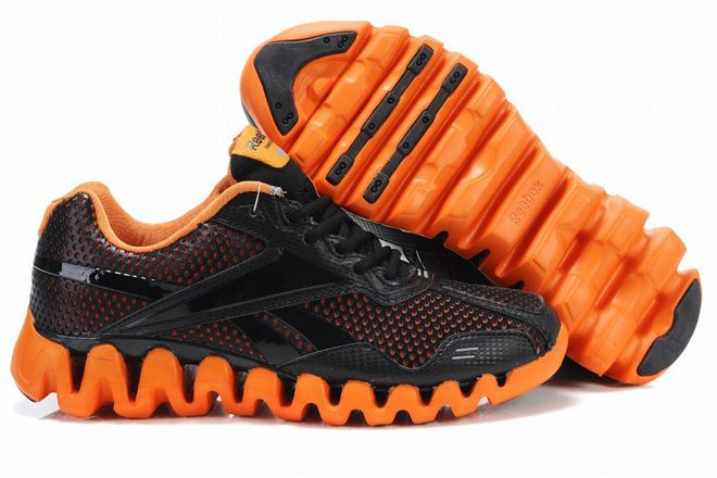 7f27d569664e Reebok zigtech trainers black and orange