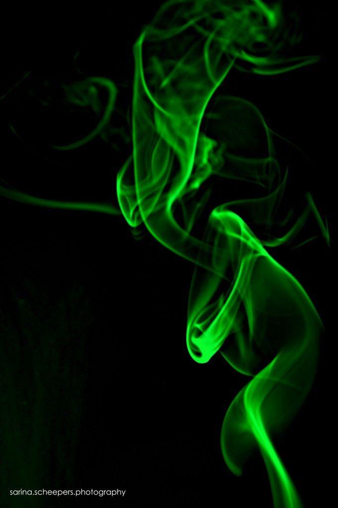 green rising smoke on black background wallpaper iphone ...  green rising sm...