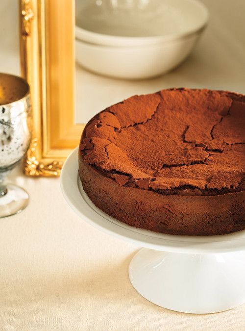 Chocolate Truffle Cake. INGREDIENTS: 225 g (8 oz) dark chocolate, coarsely chopped, 180 ml (¾ cup) unsalted butter, cut into cubes, 5 eggs, 250 ml (1 cup) brown sugar, 1 ml (¼ teaspoon) salt, 60 ml (¼ cup) unbleached all-purpose flour, 15 ml (1 tablespoon) cocoa powder