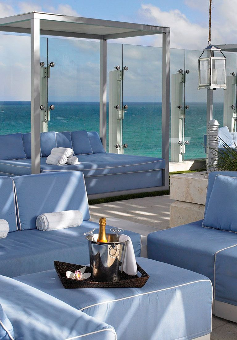 The rooftop pool lounge offers stunning panoramic ocean views ...
