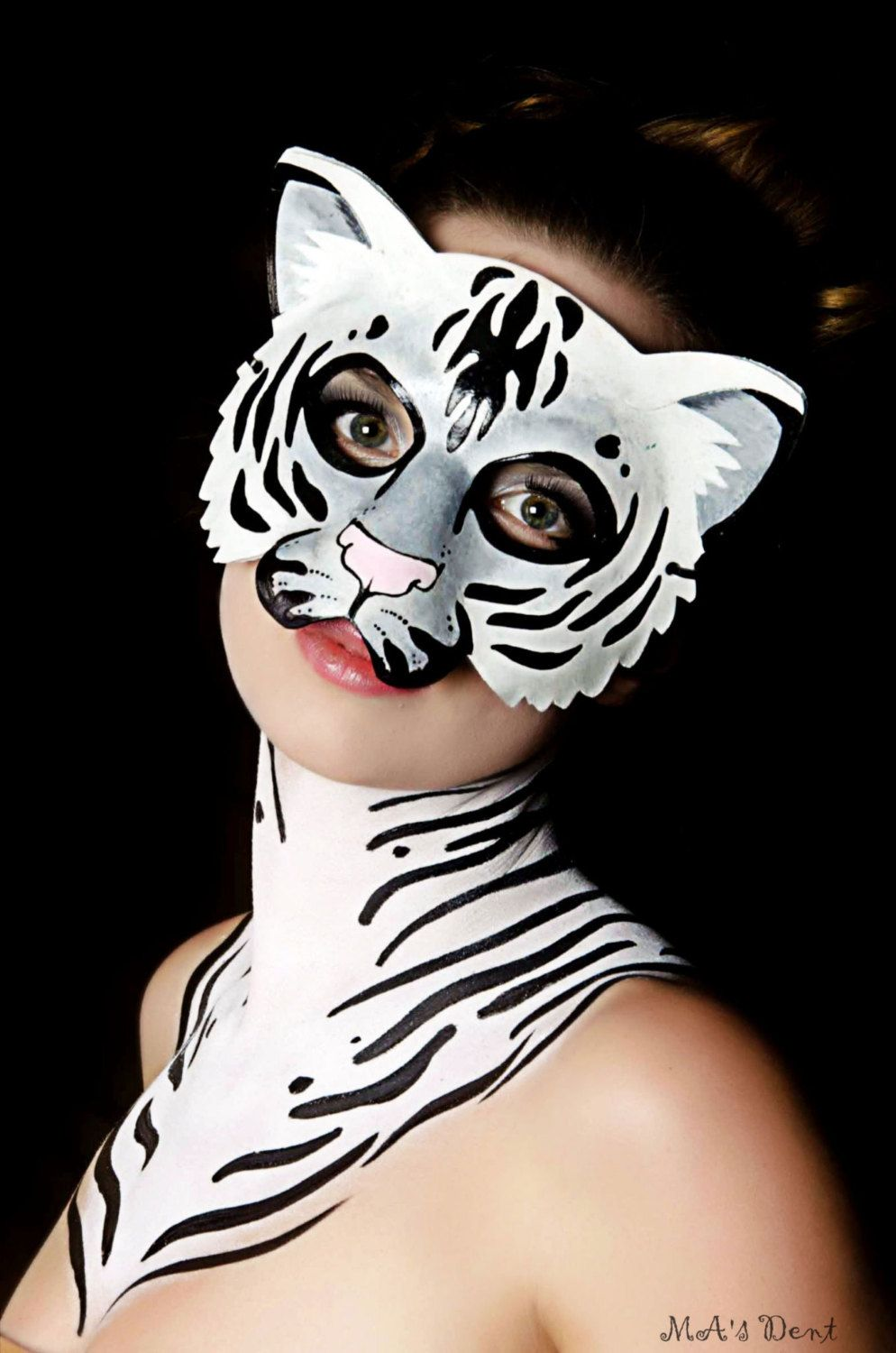 White tiger leather mask.... $80.00, via Etsy.