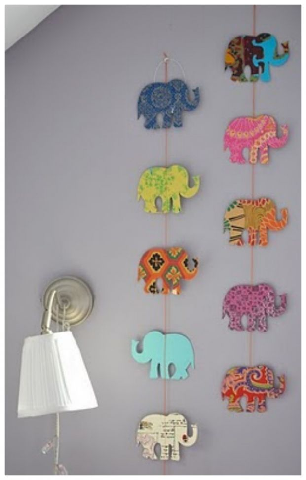 Cut out any image you want - hearts, initials, etc. with different decorative scrap paper Tape it on to a string Hang it down the wall