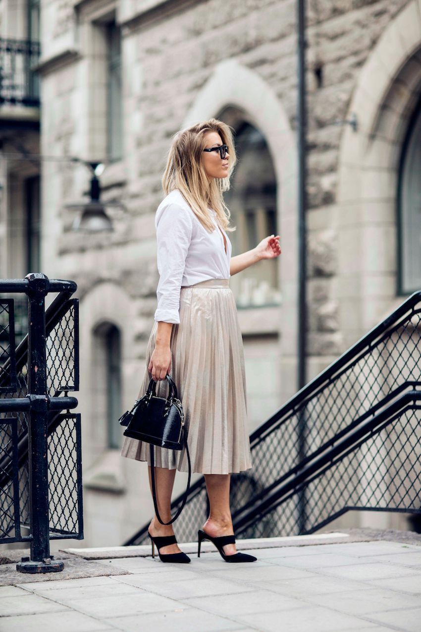 Linda Juhola in white shirt from Gina Tricot, pleated rose gold skirt from Zara, Louis Vuitton bag, Prada sunglasses and Mango shoes