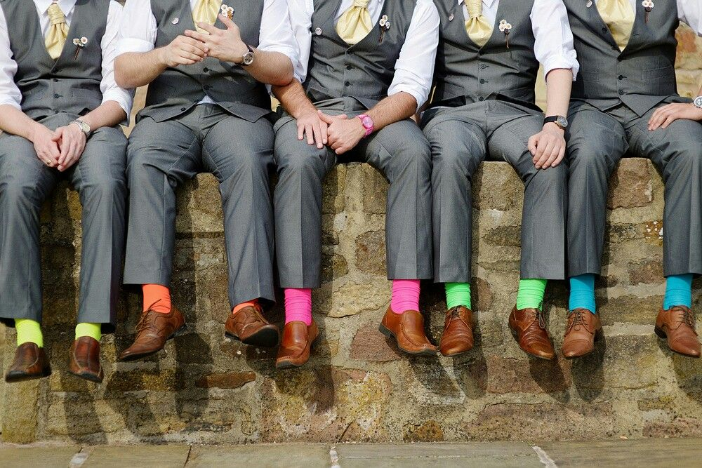 Another wedding trend for grooms & groomsmen... Brightly colored socks. Yay or nay? Let us know in the comments. 😉 #PutARingOnIt 💎💍  #groom #groomsmen #menswear #mensfashion #friendshipgoals #relationshipgoals #dapper #classicman